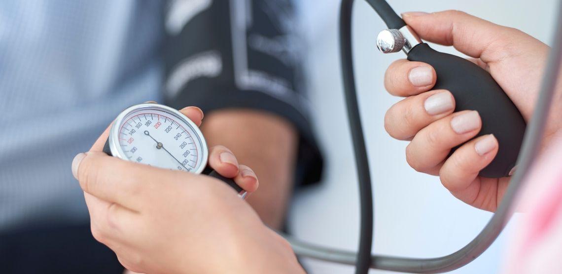 Someone getting their blood pressure measured.