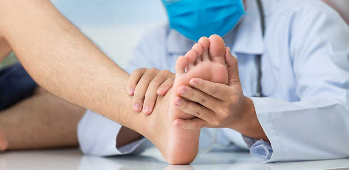 a doctor examining a patient's foot for plantar fasciitis