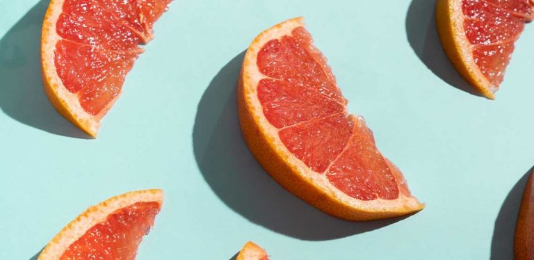 A photo of several slices of grapefruit, one of the foods that can trigger atrial fibrillation.